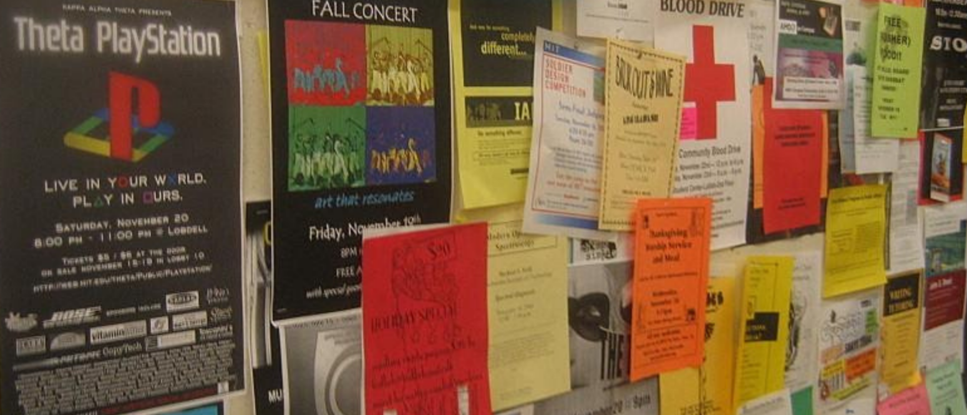 A bulletin board at MIT with layers of sticky flyers